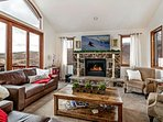 Gorgeous living room with gas fireplace, ample seating and amazing views!