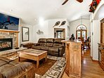Inviting living room with plush sofas, gas fireplace, large flat screen TV and dry bar.