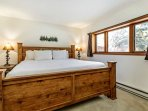 Venture downstairs to the master bedroom featuring a king bed.