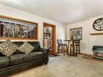 Lower level den features a wet bar, high ball table, gas fireplace and flat screen TV. The perfect getaway!