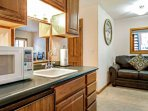 The wet bar is complete with mini refrigerator, sink and microwave for your convenience.