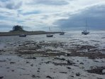 Tidal, Lindisfarne Island looking at the castle
