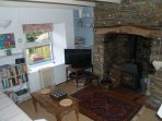 Cosy sitting room with logburner,logs included. Satellite TV lots of books and information ,WIFI