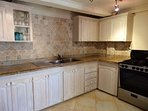 Fully equipped kitchen with fridge/ freezer, microwave, oven, gas stove e.t.