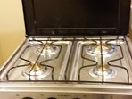 SMALL GAS STOVE IN KITCHENETTE