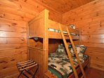 This quaint little nook area features the Twin over Full Bunk Bed for extra guests.