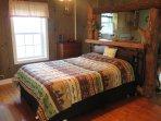Queen size bed on main floor with memory foam mattress.