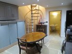 The kitchen in Butterpot Cottage, spiral staircase leading to the double bedroom....
