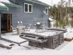Rear deck with seating, gas grill and hot tub