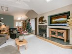 Large flat screen TV and gas fireplace in the family room