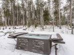 Soak in your private hot tub while surrounded by forest views