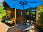 Your own private patio with a swing for two, gas grill, table chairs and shade when needed. Enjoy!