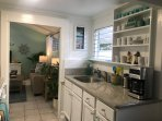 A WELL APPOINTED KITCHEN WITH G/D, ELECTRIC STOVE, FRIG, OVEN, MICROWAVE, COFFEE MAKER AND MORE.