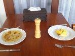 Banana pancake and scrambled eggs. Many breakfast choices.