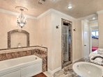 The master bathroom features a jetted garden tub and dual-head shower.