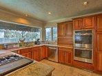 Stainless steel appliances and ample granite countertops allow you to whip up gourmet recipes with ease.