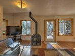 This 1,500-square-foot home accommodates up to 8 guests and features hardwood floors throughout.