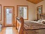 Lined with tongue and groove pine paneled ceilings, the master bedroom offers a sleigh bed with a California King...