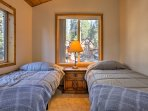 Kids can get a full night's rest in this fourth bedroom with 2 twin beds.