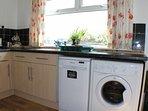 Kitchen with washing machine, dishwasher