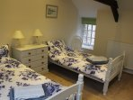 Twin bedroom with original barn exposed beans