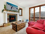 Retreat to the lowest level den with gas fireplace and access to the lower level deck with hot tub.