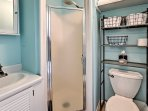 The full bathroom offers a walk-in shower and plenty of storage space to host all of your travel toiletries.
