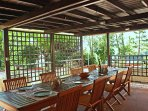 Wide pergola with table and chairs for al fresco dining and relaxing