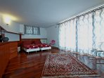 Wide bedroom with two single beds and panoramic terrace