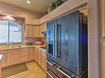 The kitchen has plenty of space for your entertainment needs.