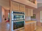 Prepare a tasty treat using gourmet appliances in the fully equipped kitchen.