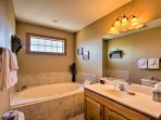 Enjoy a nice soak in this Jacuzzi tub before heading to bed.