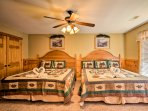 Drift off into a peaceful night of sleep while cuddling in these 2 queen beds.