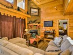 Admire the home's rustic wood paneling while staying warm in front of the fire.
