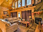Boasting 3,600 square feet of living space, this cabin offers accommodations for 16 guests.