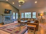 Vaulted ceilings and picture windows foster a peaceful ambiance throughout the interior.