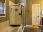 The master en-suite bathroom features a walk-in shower and a separate bathtub.