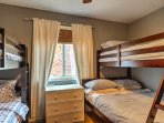 Share this bedroom with a twin-over-twin bunk bed and a twin-over-full bunk bed with your siblings or friends.