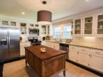 There's plenty of room in the well lit, newly-renovated kitchen for you and your guests.