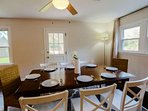 The dining room table comfortably sits 8 people.  The door in this photo leads to the paved patio and backyard.