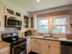 This expansive kitchen has granite countertops, stainless steel appliances and sweeping views of the home's backyard.