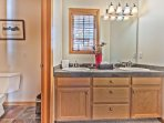 Upper Level Shared Dual Sinks and a Separate 3-Piece Bathroom with a Tub/Shower