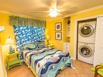 Full size bed with new bedding and Washer and dryer for laundry convenience