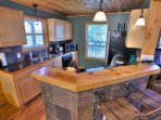 Kitchen w/ Solid Wood and Slate Bar