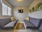 This upstairs living room hosts 2 cozy futons available for an additional $100 fee.