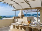 Roof top entertainment area with granite and marble table and sea view