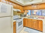 Boasting endless cabinet and counter space, this kitchen has everything you'll need.