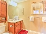 Rinse off the sand and sunscreen in this spacious bathroom.