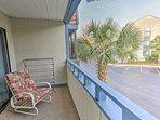 The balconies overlook the community amenities.
