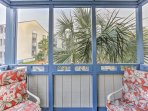 Find relief from the summer mosquitoes in the screened-in balcony.